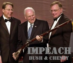 Vice President Dick Cheney, center, accepts a rifle from National Rifle Association President Kayne Robinson, right, and NRA Vice President Wayne R. LaPierre. Cheney later accidentally shot and injured a man during a weekend quail hunting trip in Texas